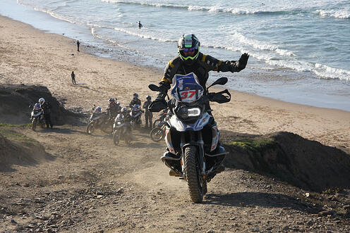 riding dirt bike on beach